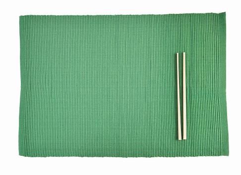 chopsticks on sushi mat 611758856