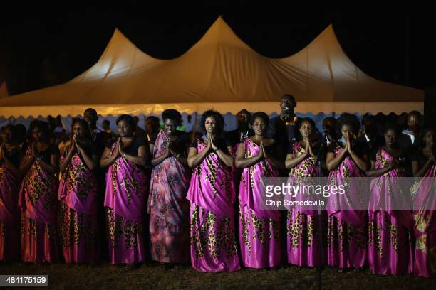 Chorale Abagenzi singers performs during a genocide commemoration ceremony at the Nyanza-Kicukiro, 20 years after 2,000 people were killed by the...