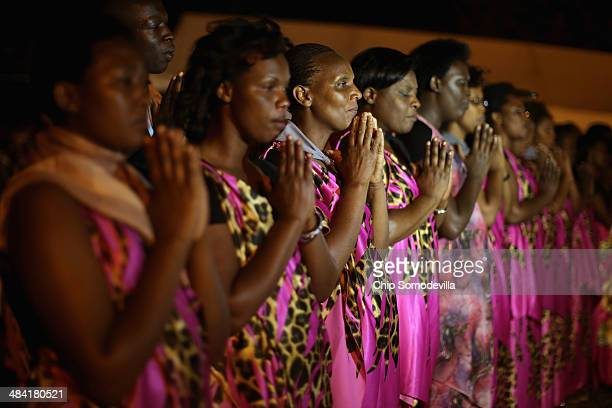 Chorale Abagenzi singers performs during a genocide commemoration ceremony at the NyanzaKicukiro 20 years after 2000 people were killed by the...