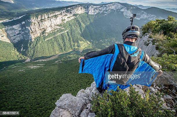 Choranche Wingsuiter with a black and blue wingsuit about to jump in the Bourne Gorges Vercors Regional Natural Park between PontenRoyans and...