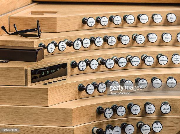 Chord buttons on pipe organ.