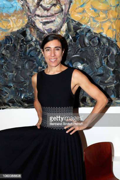 Choregrapher Bianca Li poses in front of a portrait of Azzedine Alaia by Julian Schnabel during Alaia Foundation Library Opening at Gallery Azzedine...
