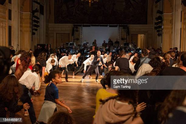 Choreographer and performer Mourad Merzouki leads an interactive performance by the French Olympic Dance Team at the opening of the 20th annual Nuit...