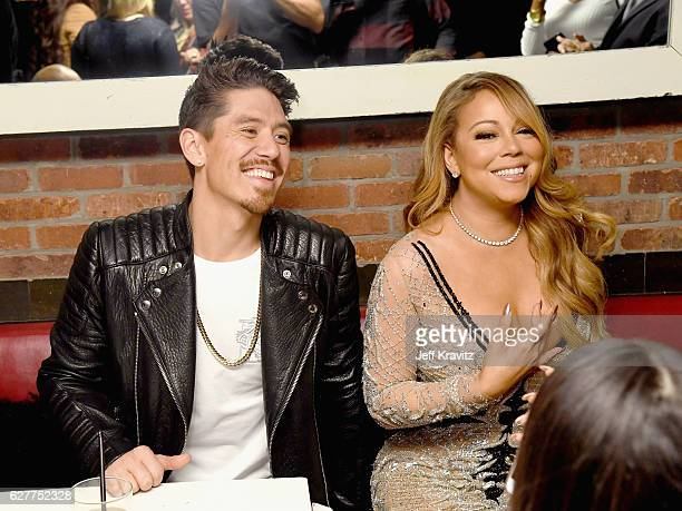 Choreographer Bryan Tanaka and recording artist Mariah Carey attend MARIAH'S WORLD Viewing Party at Catch on December 4 2016 in New York City