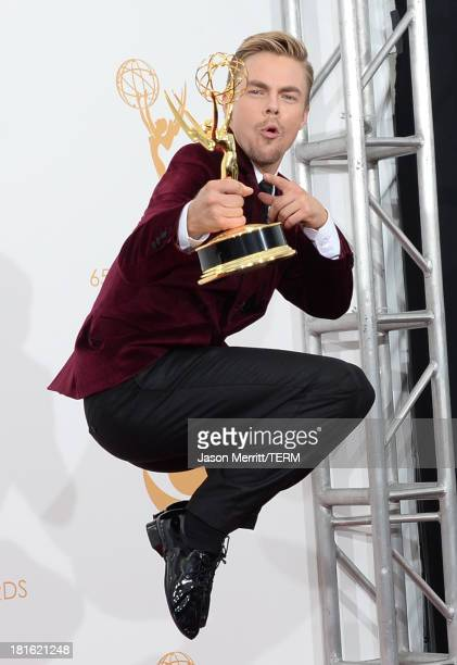 Choreographer Derek Hough winner of the Best Choreography Award for Dancing With The Stars poses in the press room during the 65th Annual Primetime...