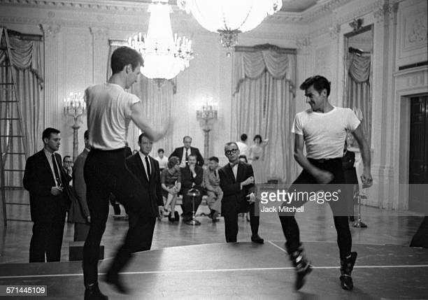 Choreographer Eugene Loring watches ABT dancers rehearsing 'Billy the Kid' in the White House East Room May 22 1962