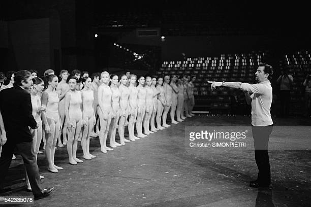 Choreographer Maurice Bejart gives instructions during a rehearsal for the ballet L'Oiseau de Feu , created in Paris.