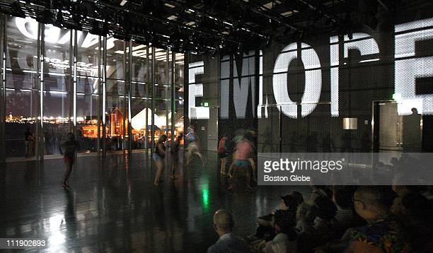 Choreographer Miguel Gutierrez and the Powerful People perform as light projection by artist Jenny Holzer shines into the Institute of Contemporary...