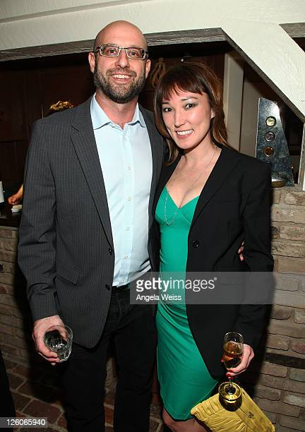 Choreographer Tony Testa and Lotus Donovan attend the Friends N Family Dinner at The Jack Warner Estate on February 10 2011 in Los Angeles California