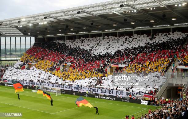 A choreography of Fanclub National Team prior to the UEFA Euro 2020 Qualifier match between Germany and Estonia at Opel Arena on June 11 2019 in...