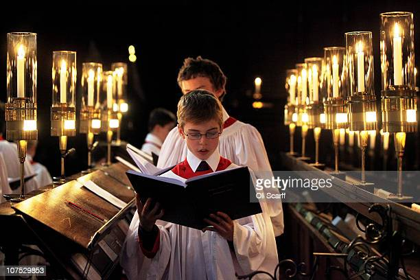 Chorister in the choir of King's College Cambridge sings during a rehearsal of their Christmas Eve service of 'A Festival of Nine Lessons and Carols'...