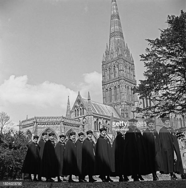 Choristers from Salisbury Cathedral School walk in line in front of the cathedral in Salisbury, England during World War II on 21st May 1941.