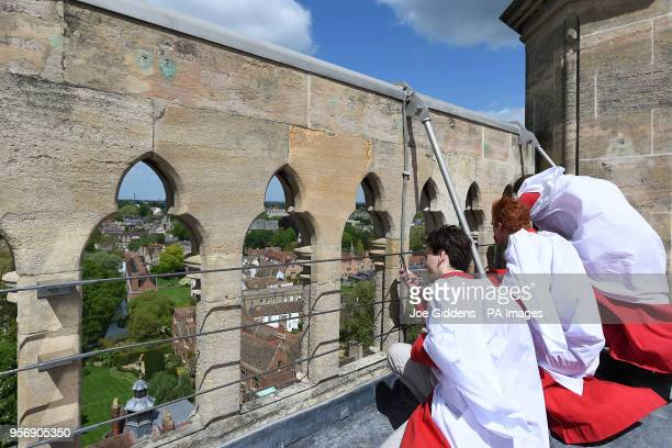 Choristers from St John's College Cambridge take in the view before performing the Ascension Day carol from the top of the Chapel Tower at St John's...
