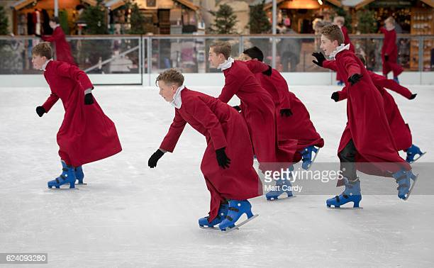 Choristers from Winchester Cathedral don ice skates to try out the recently installed artificial ice rink beside the cathedral which opens today on...