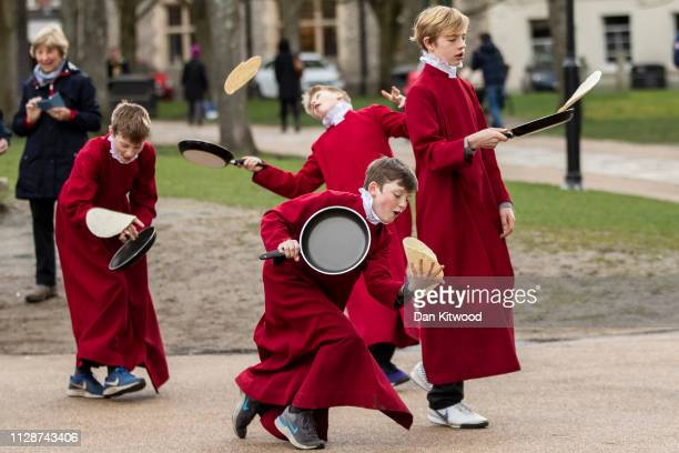 Choristers from Winchester Cathedral joke around in between being posed up for pictures by photographers on March 5 2019 in Winchester England...