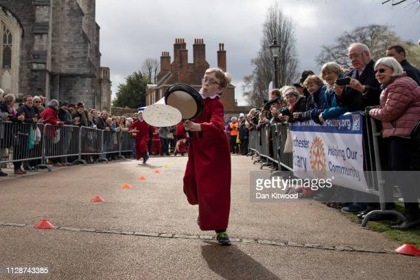 Choristers from Winchester Cathedral take part in a pancake race at Winchester Cathedral on March 5 2019 in Winchester England Winchester Cathedral...