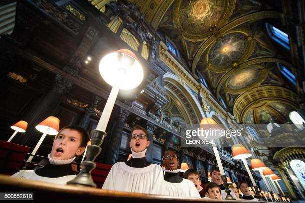 Choristers of St Paul's cathedral rehearse in the quire of the cathedral in central London on December 9 2015 The choristers will be performing...