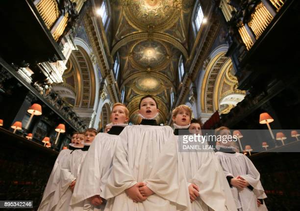 Choristers sing during a rehearsal for their upcoming Christmas performances at St Paul's Cathedral in central London on December 19 2017 / AFP PHOTO...