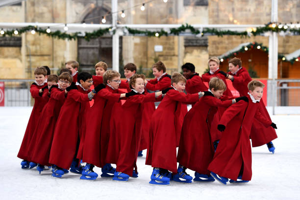 GBR: Choristers Skate On Winchester Cathedral's Ice Rink