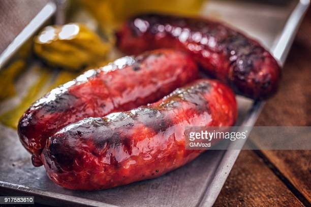 chorizo sausages with mustard - chorizo stock pictures, royalty-free photos & images
