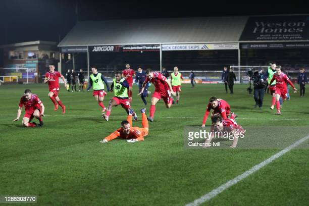 Chorley FC players celebrate following their team's victory in the FA Cup Second Round match between Peterborough United and Chorley at the Weston...