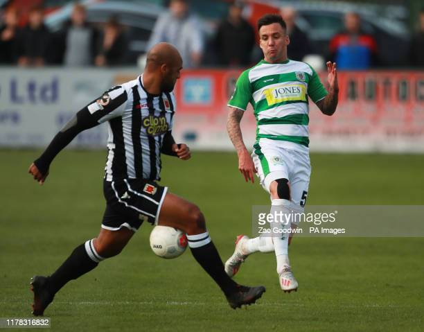Chorley's Courtney Meppen-Walter and Yeovil Town's Jimmy Smith battle for the ball during the National League match at Victory Park, Chorley.