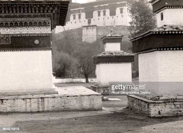 Chorten at Paro part of the Dzong in background Built in 1646 the 'Paro Dzong' stands in the beautiful Paro Valley on the foundations of an old...