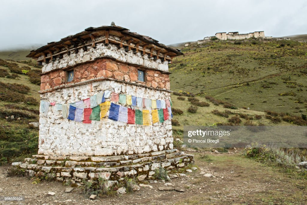 Chorten with prayer flags near the Lingshi dzong, Thimphu District, Snowman Trek, Bhutan : Stock Photo