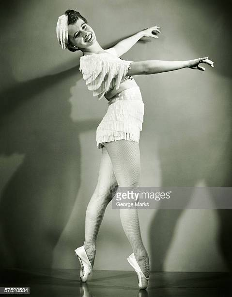 chorus girl dancing in studio, (b&w) - chorus line stock photos and pictures