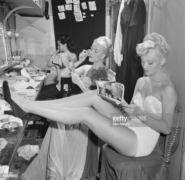 A chorus girl reads a movie magazine in a dressing room at La Scala opera house Milan November 1948