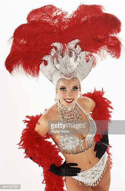 Chorus girl wearing stage costume, hands on hips, portrait, elevated view