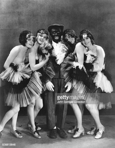 Chorus girls Greta Garde Betty Le Roy Katherine Brown and Theresa Barber surround George Moran part of the Moran and Mack vaudeville team also known...