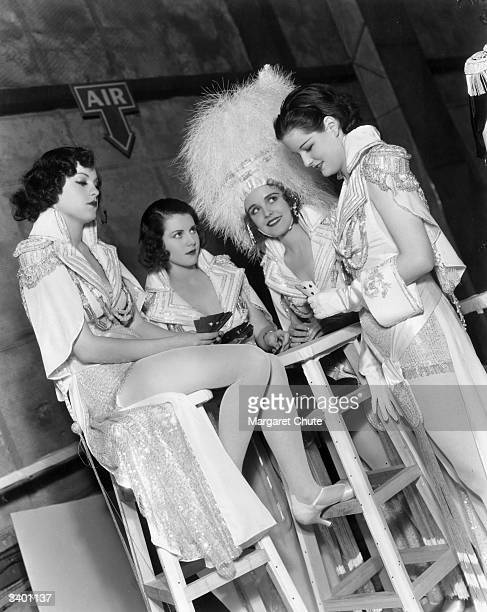 Chorus girls relax offstage during production of the film 'The Great Ziegfeld' a biopic of the Broadway impresario Florenz Ziegfeld The film was...