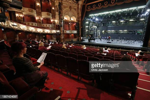 Chorus Master Mark Biggins conducts a socially seated choir during the rehearsals for Handel's Messiah at the London Coliseum on MARCH 16, 2021 in...