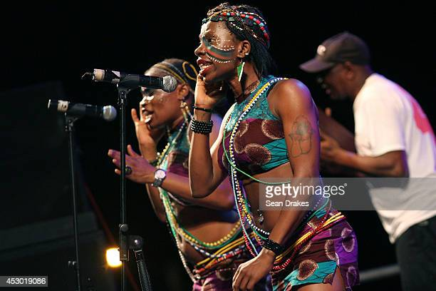 Chorus of Nigerian musician Seun Kuti perform during the opening night of the Emancipation Village at the Queen's Park Savannah on July 31 2014 in...