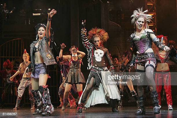 """Chorus singers and dancers perform for """"We Will Rock You"""" at the Lyric Theatre on October 8, 2004 in Sydney, Australia."""