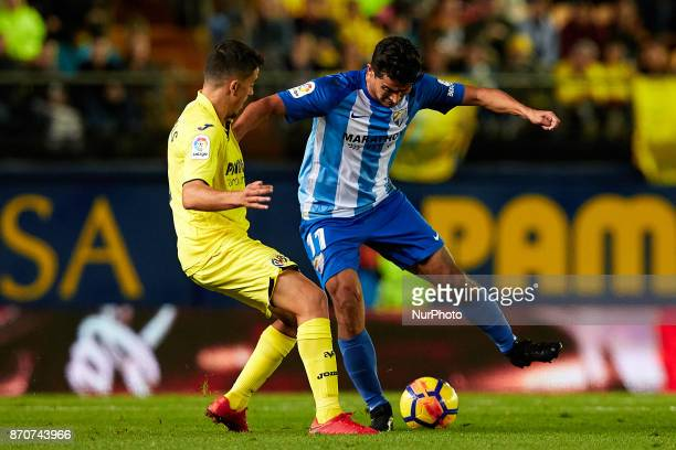 Chory of Malaga CF competes for the ball with Pablo Fornals of Villarreal CF during the La Liga match between Villarreal CF and Malaga CF at Estadio...