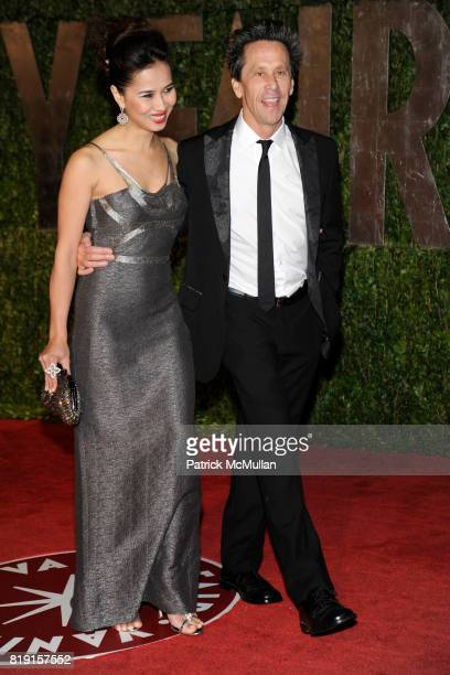 Chosan Nguyen and Brian Grazer attend VANITY FAIR Oscar Party ARRIVALS at Sunset Tower Hotel on March 7 2010 in West Hollywood California