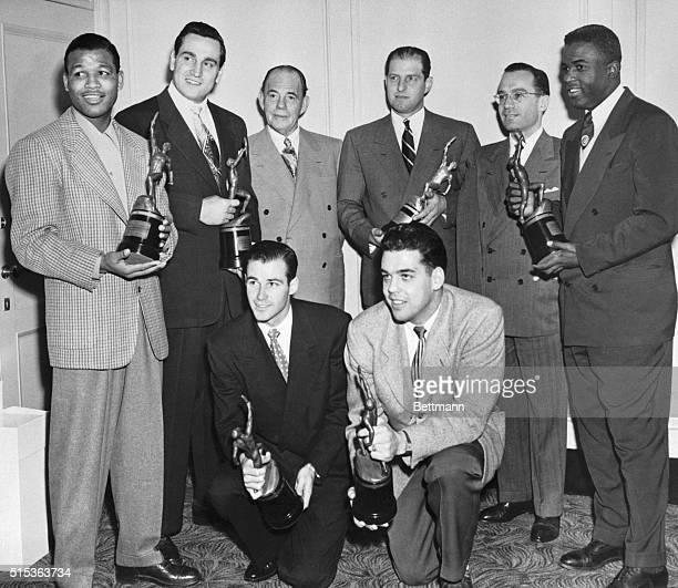 Chosen as tops in their respective fields these athletes pose with their trophies awarded by Sport magazine at a banquet at the Hotel Astor Jan 19...