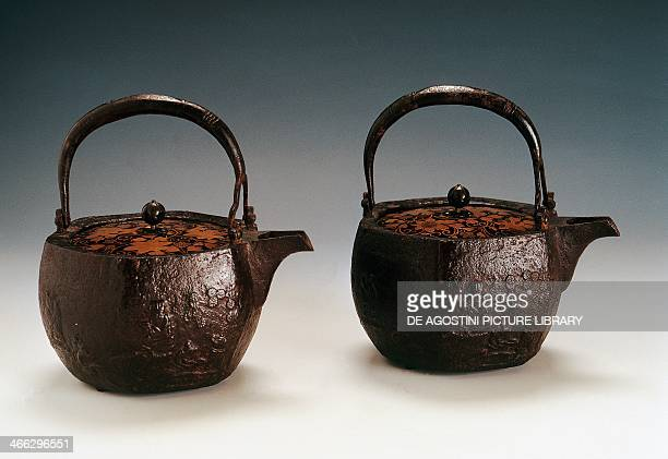 Chosi sake kettle late 18th century cast iron and copper with lacquered wood lid decorated with deer turtle four Chinese scholars under a plum tree...