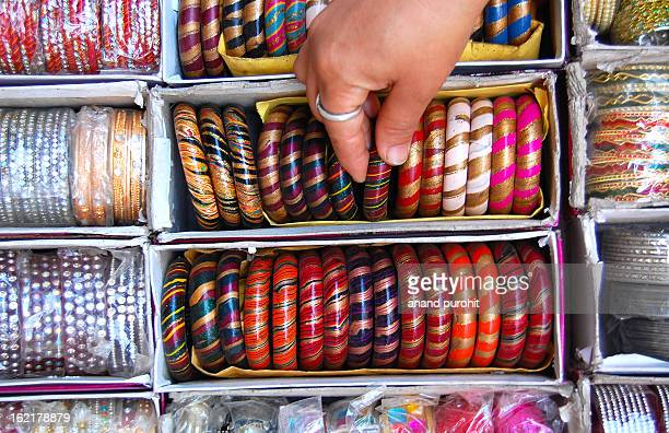 chosing lac bangles - bangle stock pictures, royalty-free photos & images