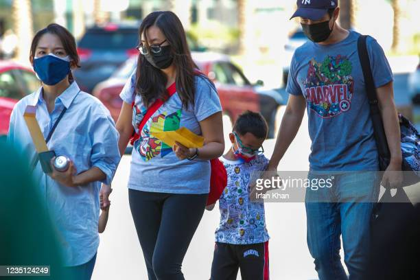 Chou family, right, at the screening of Shang-Chi and the Legend of the Ten Rings at AMC theater on Saturday, Sept. 4, 2021 in Monterey Park, CA.