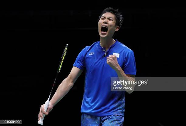 Chou Tien Chen of Chinese Taipei celebrates winning a point against Shi Yuqi of China in their men's singles quarterfinals during the Badminton World...