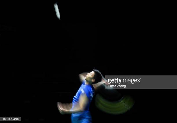 Chou Tien Chen of Chinese Taipei hits a shot against Shi Yuqi of China in their men's singles quarterfinals during the Badminton World Championships...
