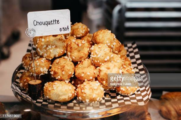 chouquette in a bakery. in a french bakery, store display. - french food stock pictures, royalty-free photos & images