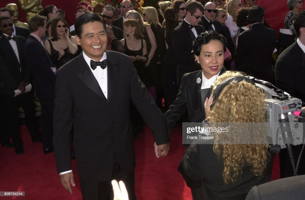 Chow Yun Fat and his wife arri...