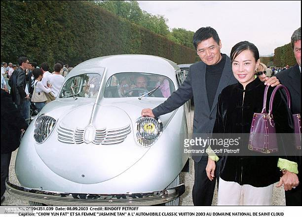 Chow Yun Fat and his wife Jasmine Tan at the Classic Automotive Vuitton 2003 at the national domain of Saint Cloud