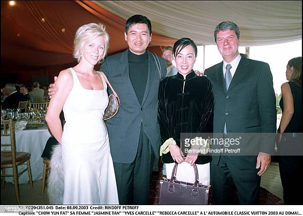 Chow Yun Fat his wife Jasmine Tan Yves Carcelle Rebecca Carcelle at the Classic Automotive Vuitton 2003 at the national domain of Saint Cloud