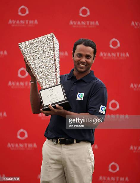 Chowrasia of India celebrates with the trophy after winning of the Avantha Masters held at The DLF Golf and Country Club on February 20, 2011 in New...
