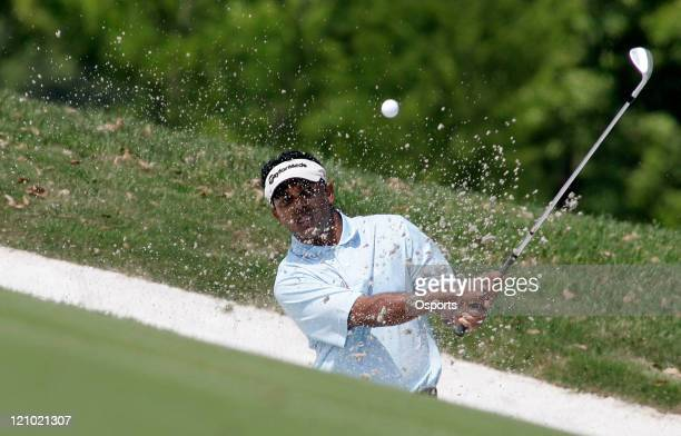 Chowrasia of India plays a shot on the 14th hole during the first round of the 2007 BMW Asian Open at the Tomson Shanghai Pudong Golf Club in...